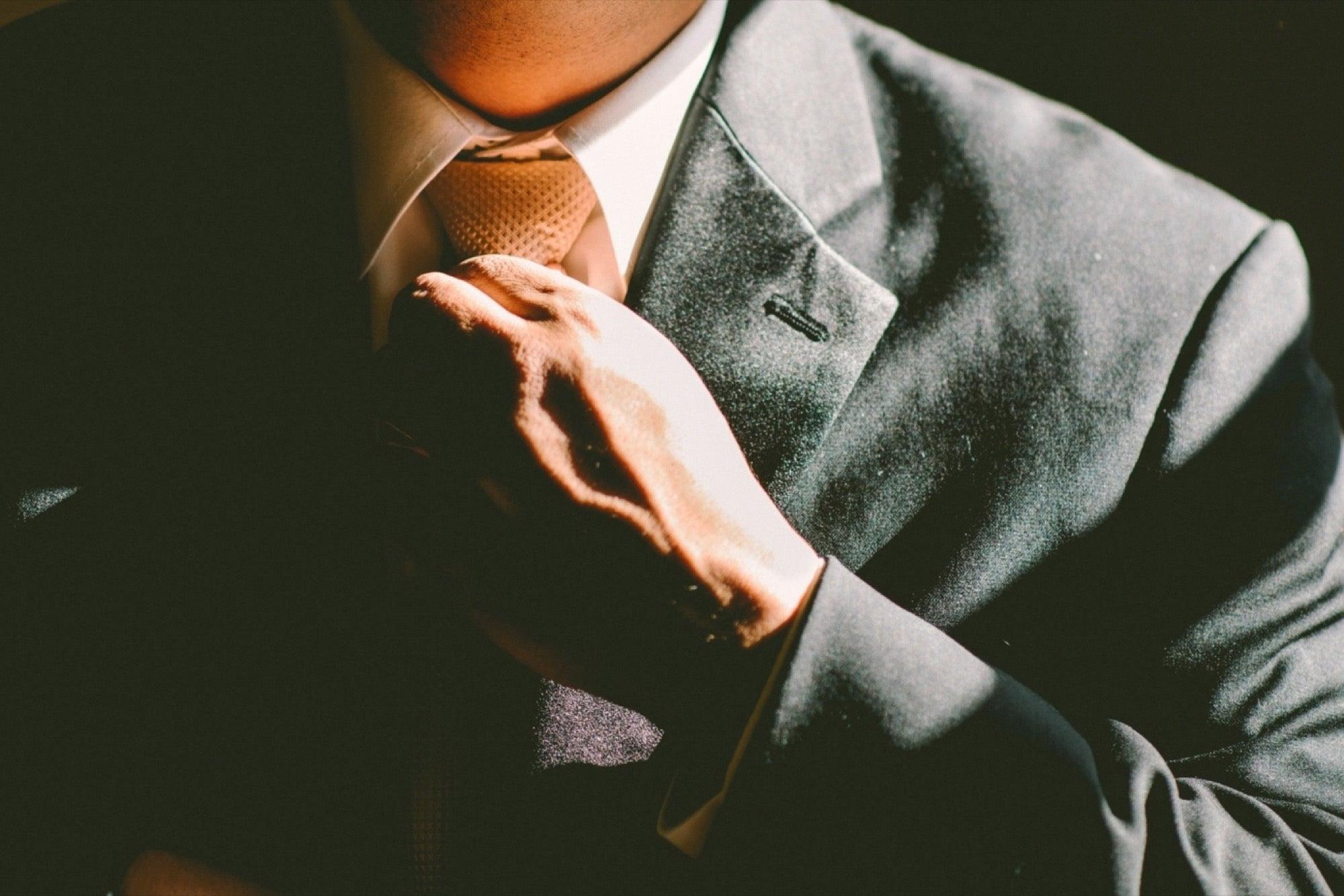 20151112144152-smooth-operator-man-businessman-suit-classy-confident-professional.jpeg